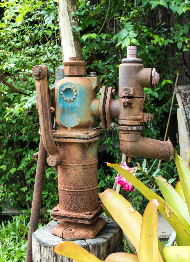 Old water pump ,vintage decoration in the local cafe at Lampang province, northern of Thailand. stock photography
