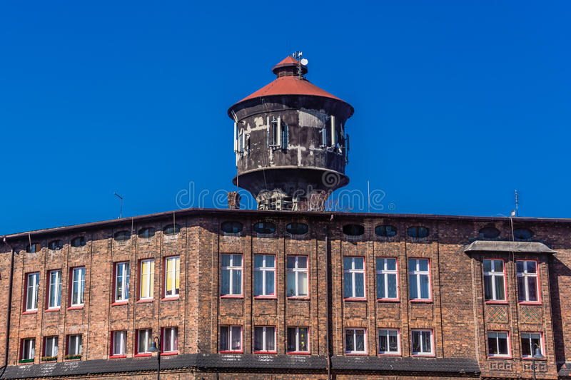 Old water tower in Nikiszowiec. District of Katowice, Silesia region Poland. The place is unique historic coal miners' settlement, built between 1908– royalty free stock photos