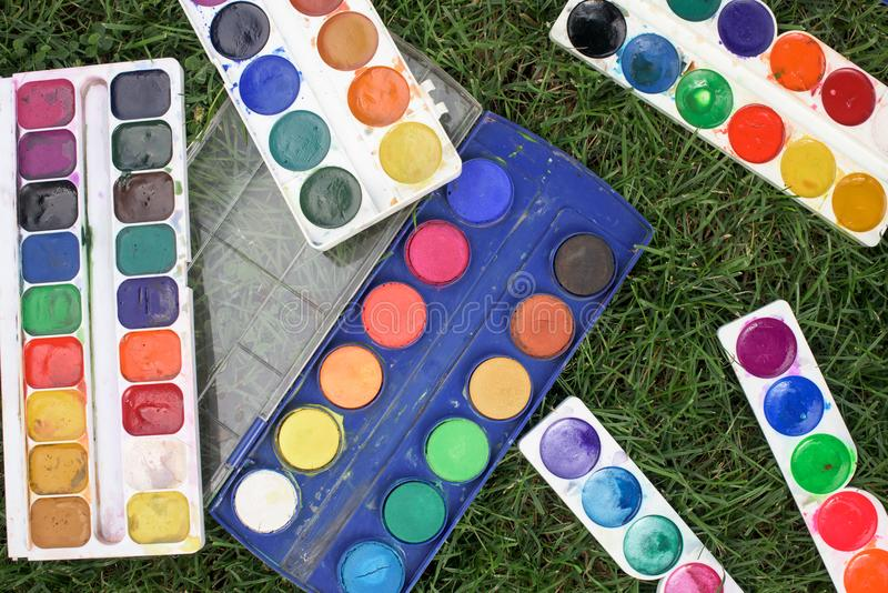 Old watercolors on a grass royalty free stock photo