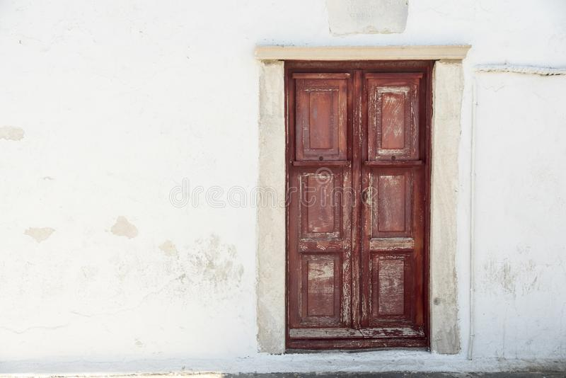 Old waterfront house door Mykonos Town Greece. Mykonos is an island in the Cyclades group in the Aegean Sea. It`s popularly known for its summer party stock photo