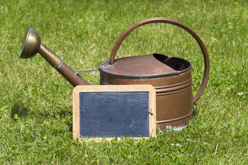 Old watering can and a slate
