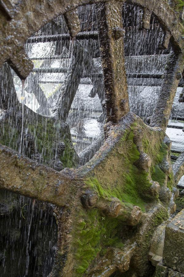 Old waterwheel on river Sorgue in old town Lisle-sul-la-Sorgue in Provence, France, traditional French watermill. Close up royalty free stock photography