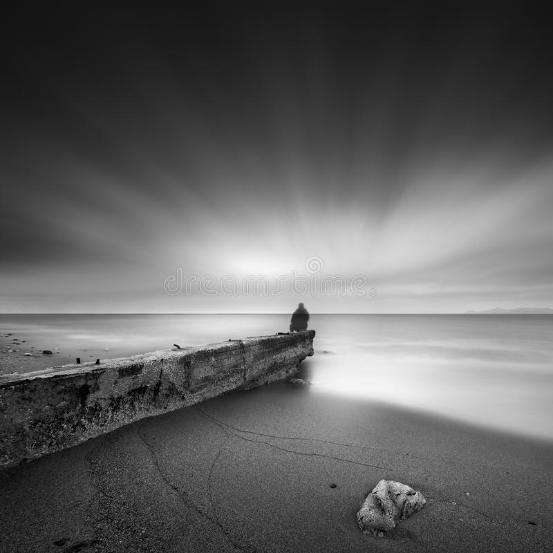 An old weatherd conctere pier in the coastal areas of Creece stock photo