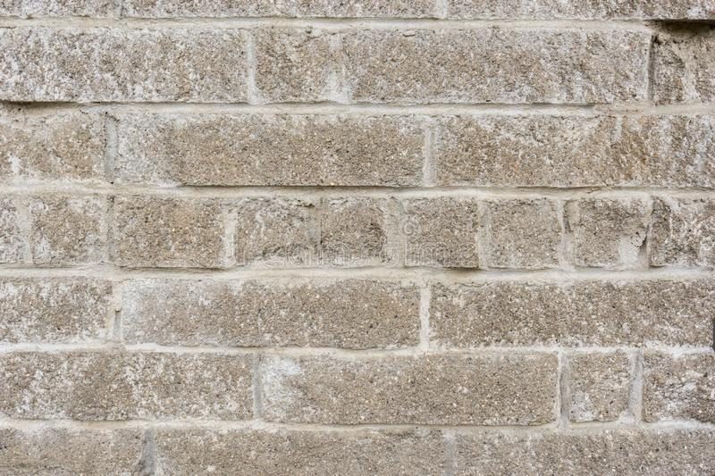 Old weathered block wall. grunge brick textured background closeup.  royalty free stock image