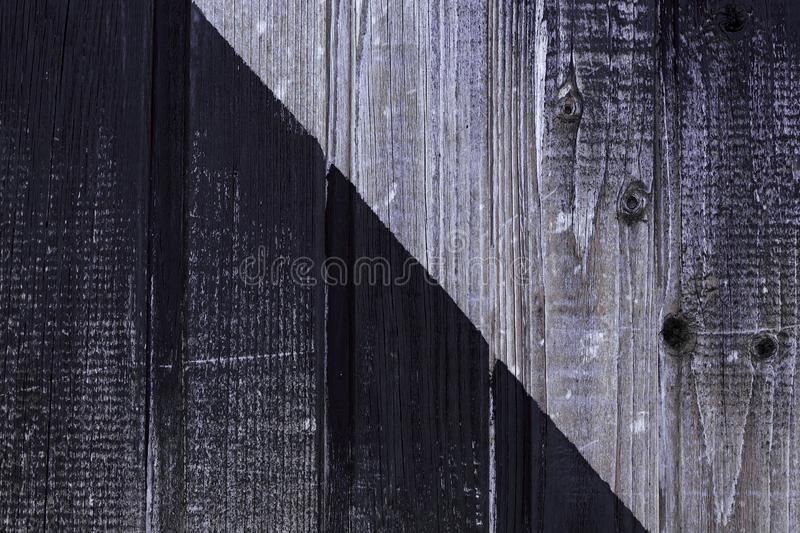 Old weathered boards. Wooden wall painted in black. Shabby wood texture. Natural background stock photography