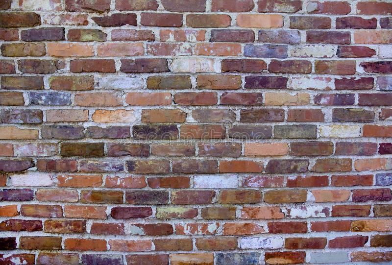 Old, Weathered Brick Wall. A background of an old, weathered brick wall with deteriorating mortar or cement royalty free stock images