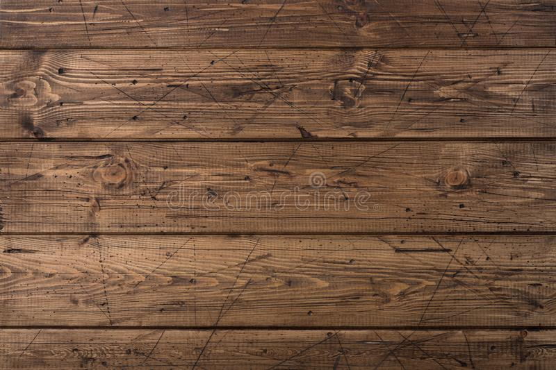 Old weathered brown wood planks texture. Grunge background. Scratched brown wooden timber background. Close up wooden texture royalty free stock images