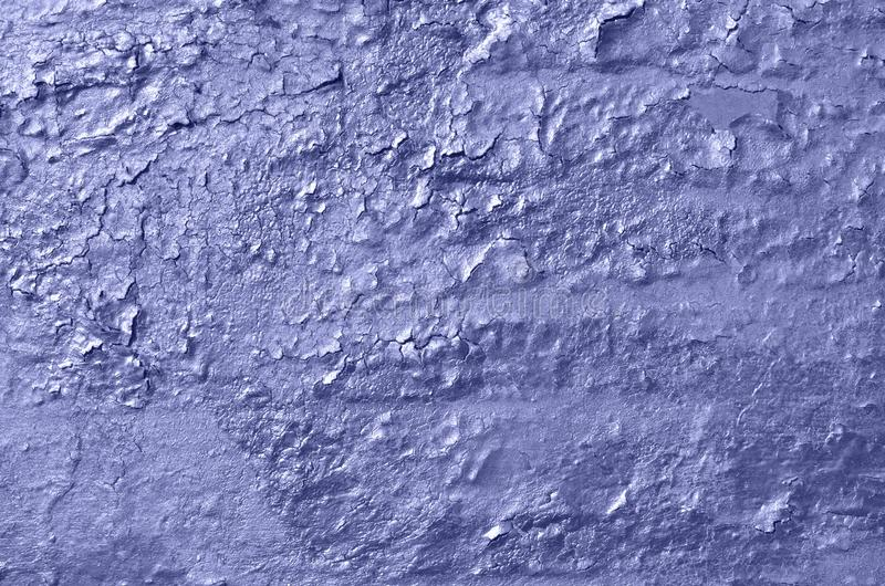Old weathered cracked peeling glossy airbrushed graffiti paint. Old weathered cracked peeling glossy airbrushed blue, purple graffiti paint on concrete wall royalty free stock photography