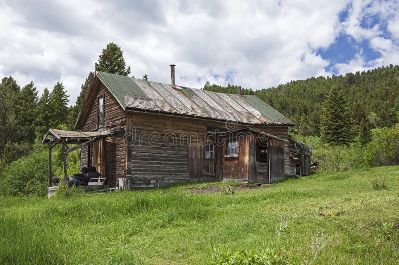 Old weathered farmhouse mountains grass stock photography