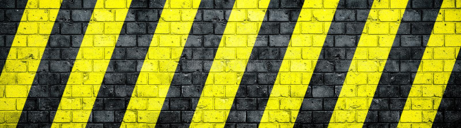 Old and weathered grungy brick wall with danger or attention black and yellow warning diagonal stripes texture background banner vector illustration
