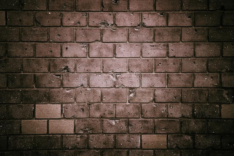Dark tones brick wall: old and weathered grungy gray concrete block brick wall texture background stock photography
