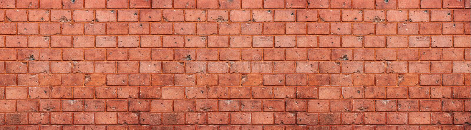 Old and weathered grungy red brick wall texture background in wide panorama format royalty free stock image