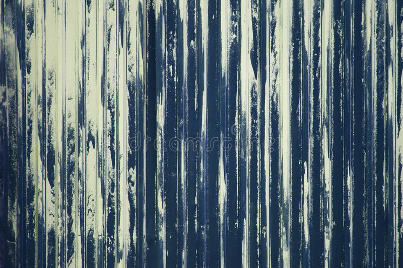 Old weathered metal surface with peeling blue paint. Industrial construction concept. Background royalty free stock image