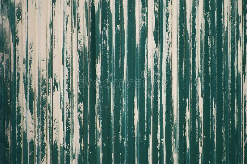 Old weathered metal surface with peeling green paint. Industrial construction concept. Background royalty free stock photography