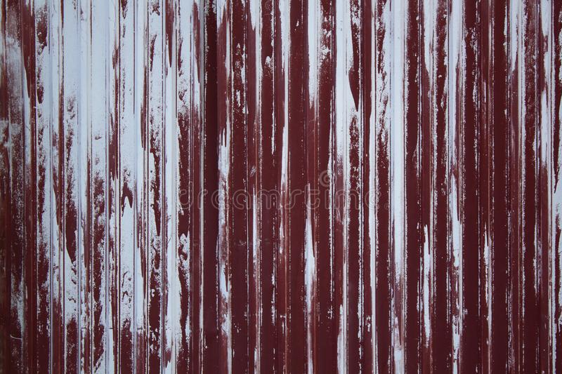 Old weathered metal surface with peeling red paint. Industrial construction concept. Background stock images