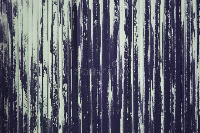 Old weathered metal surface with peeling violet paint. Industrial construction concept. Background royalty free stock photo