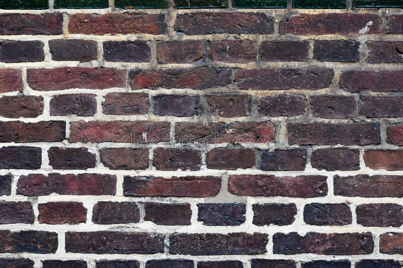 Old weathered red bricks wall texture background. For interior  or exterior design stock image