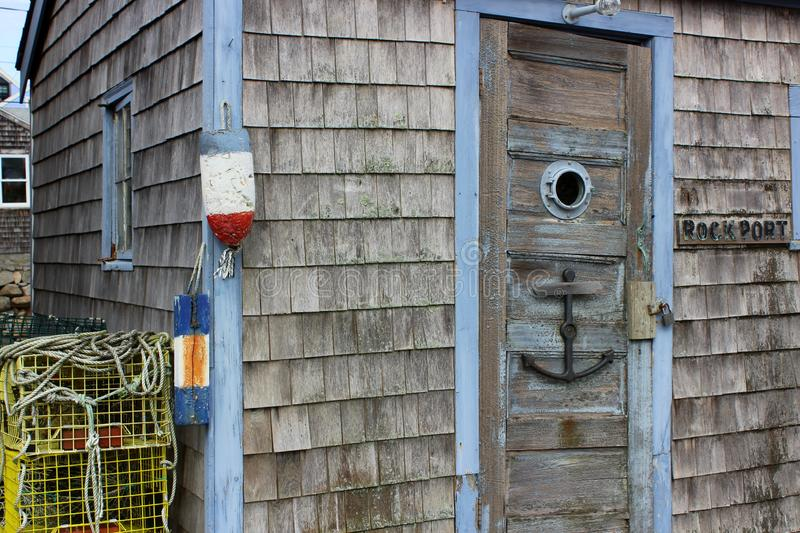 Gorgeous seaside shop with old weathered shingles and anchor on door welcoming guests in, Rockport, Massachusetts, 2018 royalty free stock image