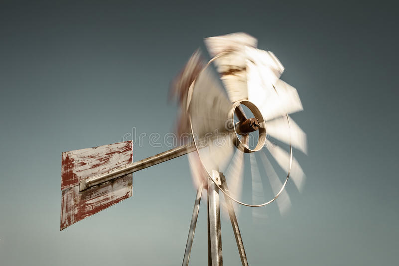 Old weathered steel windmill stock image