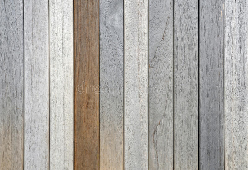 Old weathered teak planks and one oiled stock photo