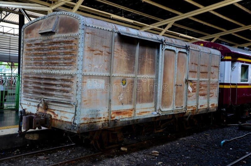 Old weathered Thai rail boxcar parked at station platform Hua Lamphong Bangkok Thailand. Bangkok, Thailand - May 4, 2017: An old brown painted weathered boxcar royalty free stock images