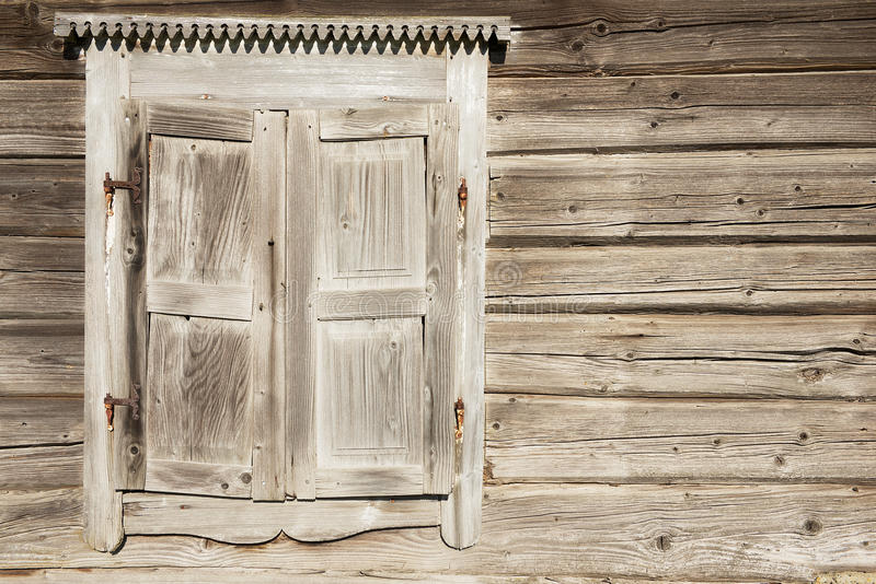 Old weathered traditional wooden window shutters. royalty free stock image