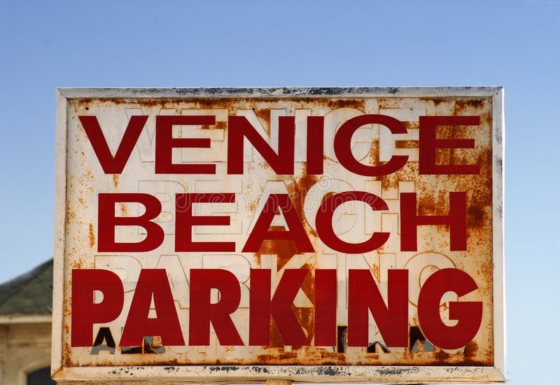 An old weathered Venice Beach parking sign stock image