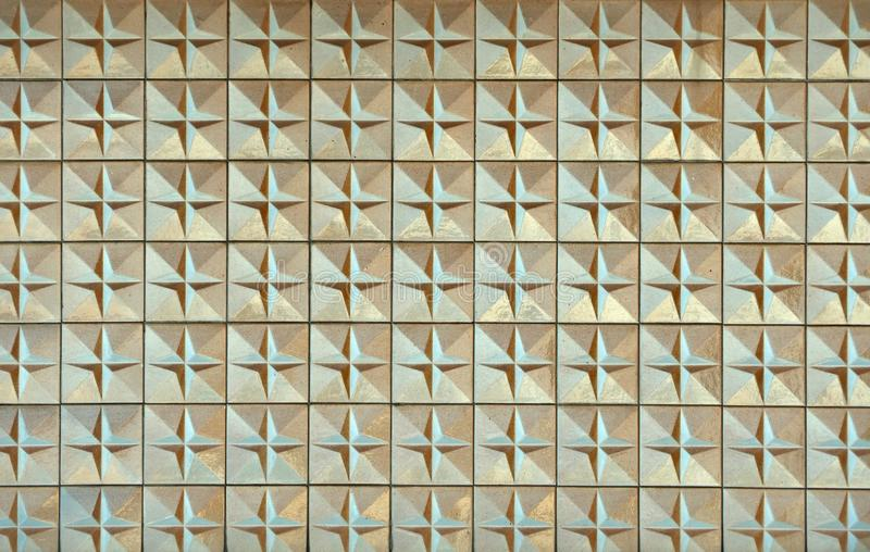 Old weathered vintage sixties tiles with faded colors and raised geometric patterns, Background and texture stock photography