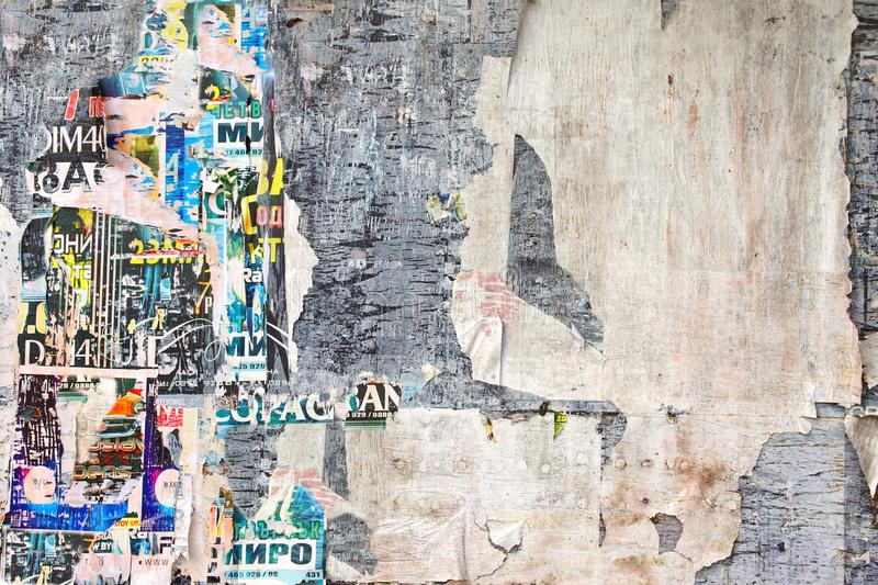 Old Weathered Wood Billboard with Torn Posters royalty free stock photos