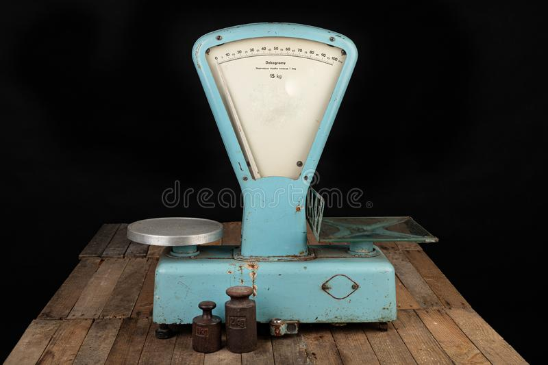 The old weight to weigh commodities from the communist era. Shop accessories on a stolen table. Dark background abacus aged ancient antique balance brass stock photo