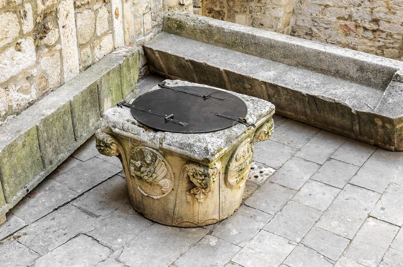 Old well in the courtyard of the castle. stock photography