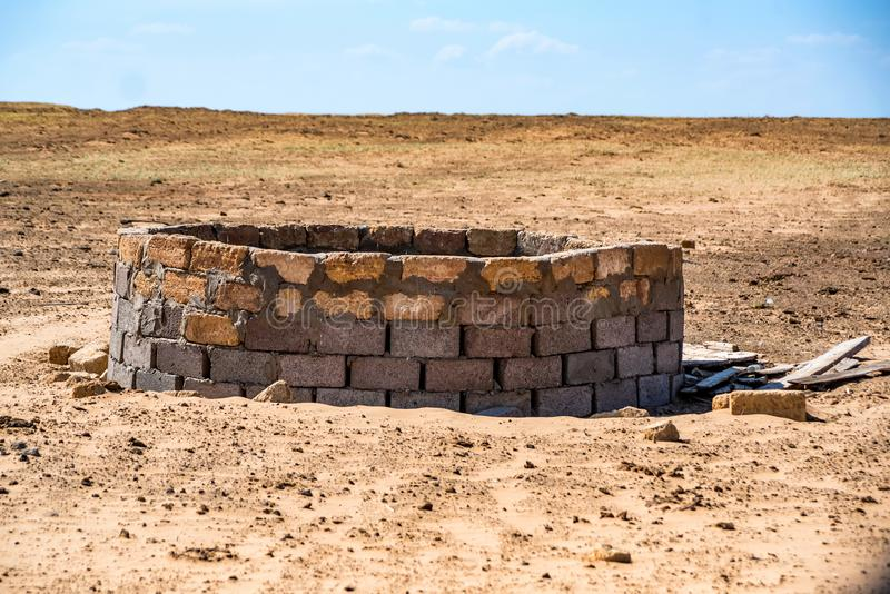 Old well in semi-desert royalty free stock photo