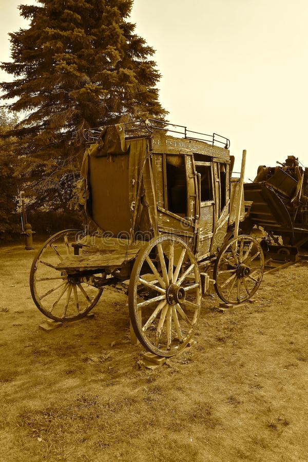 Old Wells Fargo Stagecoach sepia. JAMESTOWN, NORTH DAKOTA, July 26, 2017: The old rickety Wells Fargo stagecoach is a product of the Wells Fargo Co. founded 1690 royalty free stock photography