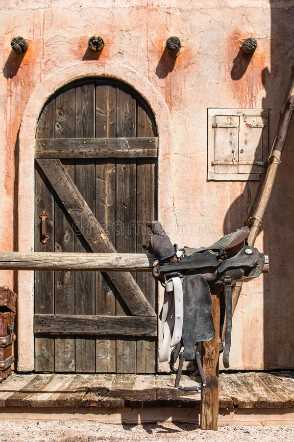 Old west cantina with saddle royalty free stock image