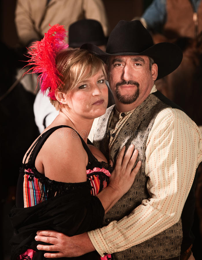 Old West Couple. Handsome men and women in old west costumes stock photos