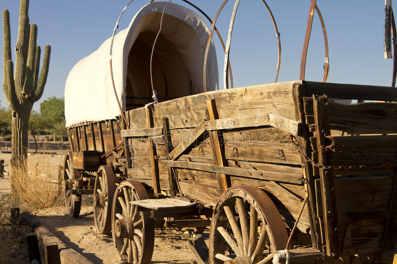 Old West Covered Wagon Train. Historic old Western covered wagons form a wagon train royalty free stock photo