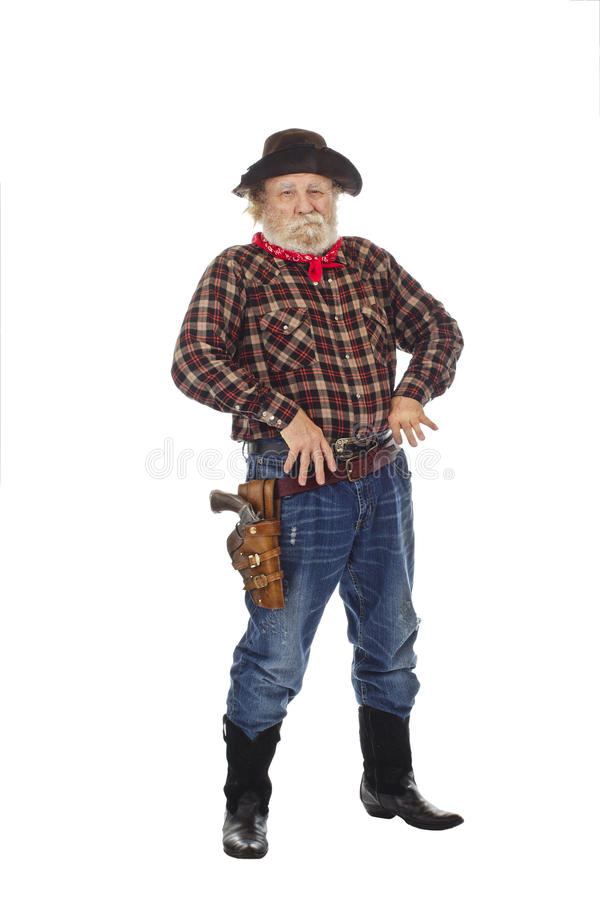Old West cowboy stands with thumbs in belt royalty free stock photos