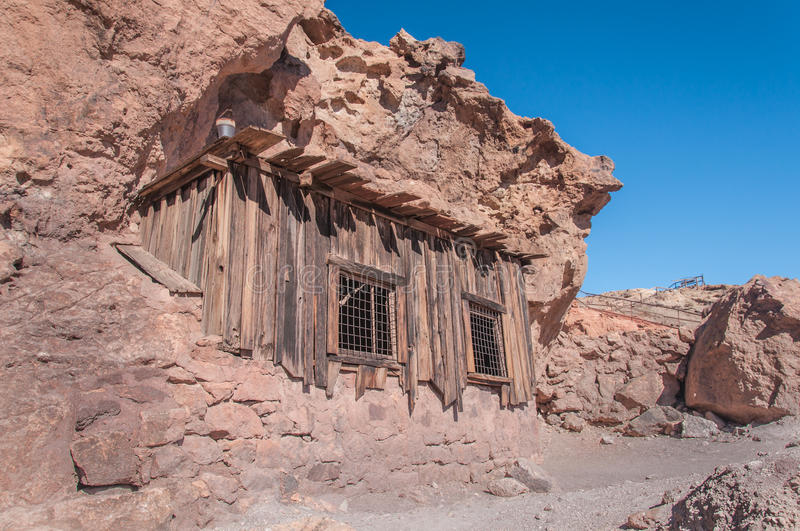 Old West Mining Shack. In the California Desert under a bright blue sky stock photo