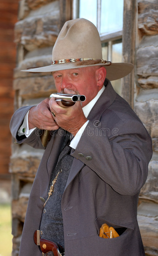 Old West Sheriff Aiming Rifle royalty free stock images