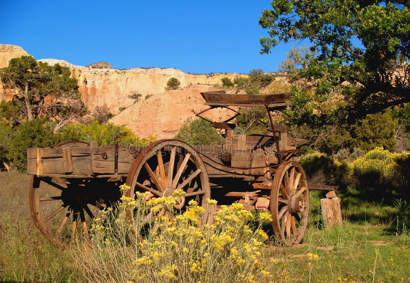 Old West Wagon. Remains of an old wooden wagon sits among the brush in the desert of northern New Mexico royalty free stock images