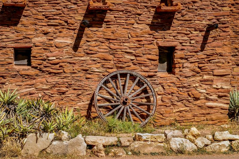 Old west Wagon Wheel. Old wagon wheel at the Hopi House in the Grand Canyon stock image