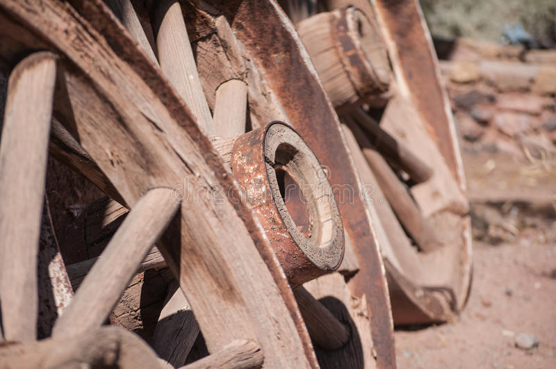Old West Wagon Wheel. Otdoors under bright sunlight royalty free stock image