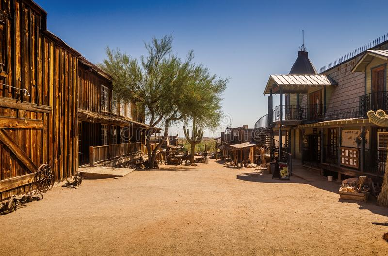 Old Western Goldfield Ghost Town square with huge cactus and saloon, photo taken during the sunny day. With clear blue sky stock photo