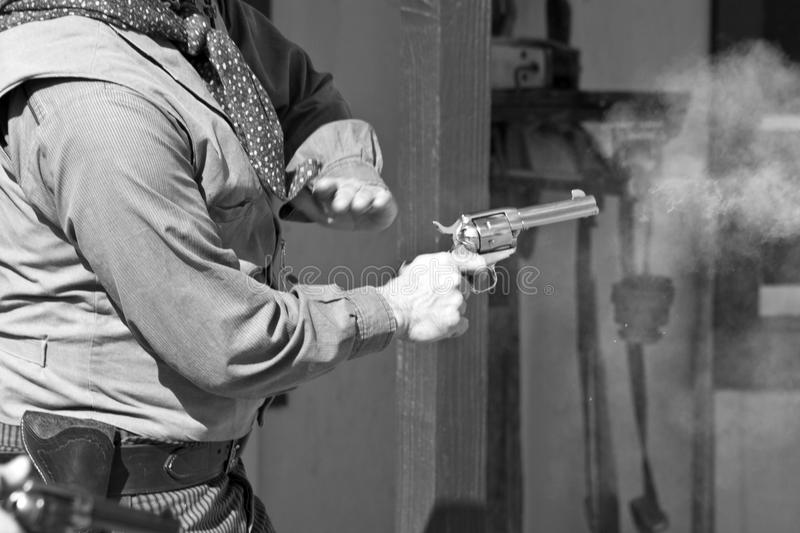 Old Western Gunfight. Old western town gunfighter fires a six gun in Arizona stock photos