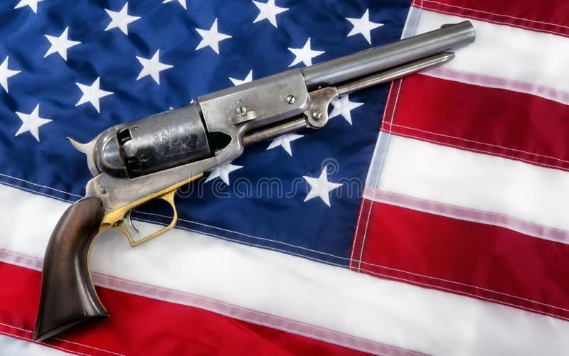 Old Western Pistol. Old western cowboy pistol on flag with room for your type royalty free stock image