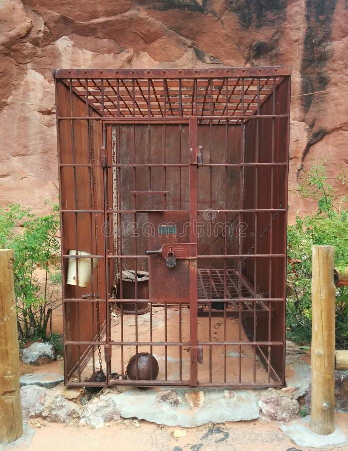 Old Western rusty metal jail cell in desert stock images