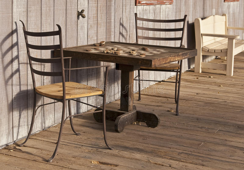 Old Western town checkerboard table stock image