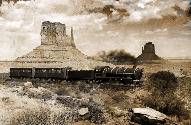 Old western train. An old steam train crossing Monument valley, in Utah. Image on a grunge background in view to give it an old and nostalgic aspect