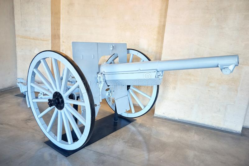 Old wheeled cannon. Very old white wheeled cannon stock photo