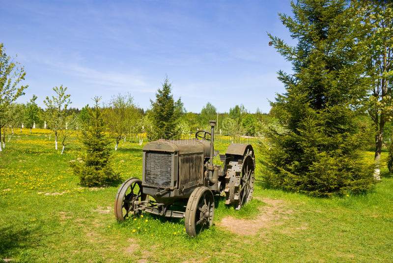 Old wheeled tractor. In village royalty free stock photos